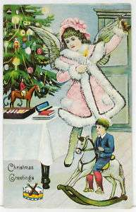 1910s Postcard ~ CHRISTMAS ANGEL wearing Pink ~ Child on Rocking Horse