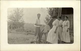 Women w Man Sharpening Stone Wheel Real Photo c1910 Postcard