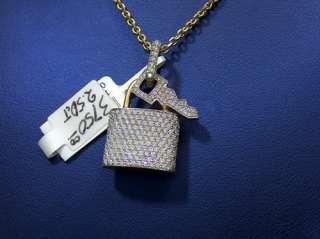 very nice 14K Yellow Gold Diamond lock & key pendant. All round cut
