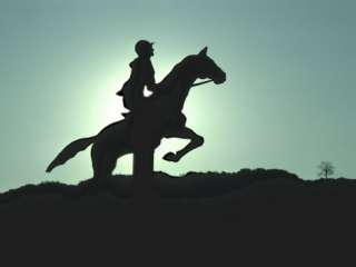 Silhouette of a Person Riding Horseback Photographic Print at