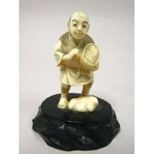 Ivory Carving of Man Holding a Basket Kitchen & Dining
