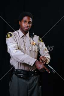 African American Sheriff with Gun Royalty Free Stock Photo
